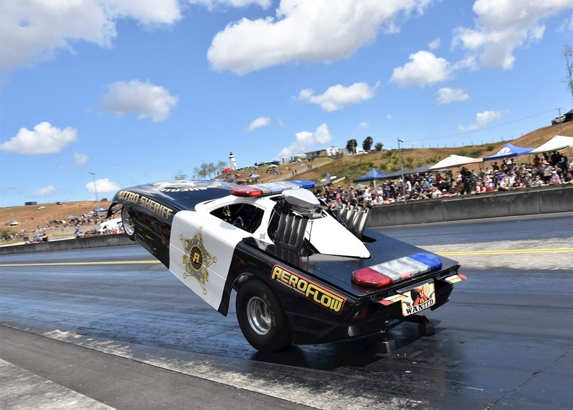 Chelsea Leahy puts the Nitro Sheriff on its rear wheels for a quarter-mile wheelstand run. Photos / Colin Smith