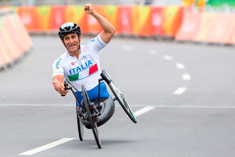 Italy's Alex Zanardi celebrates after winning the men's team relay competition.Pictures / Getty Images