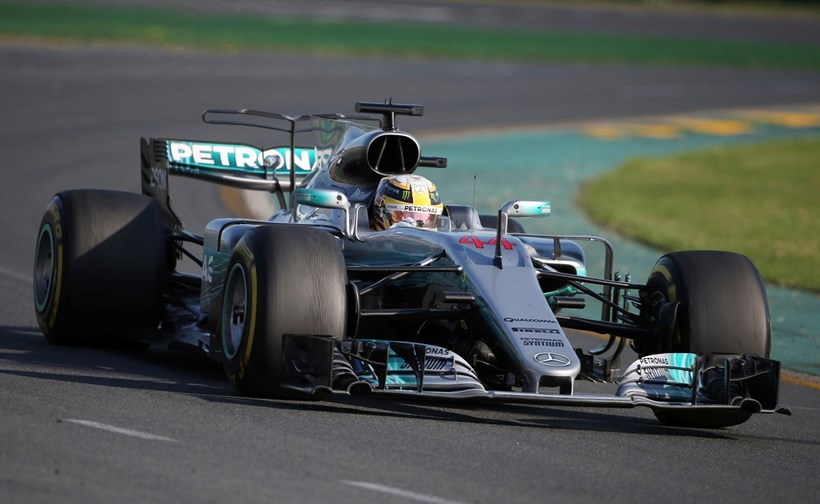 Hamilton lead into turn 1 at Australia, but Vettel would get pass him during pit stops. Photos / AP