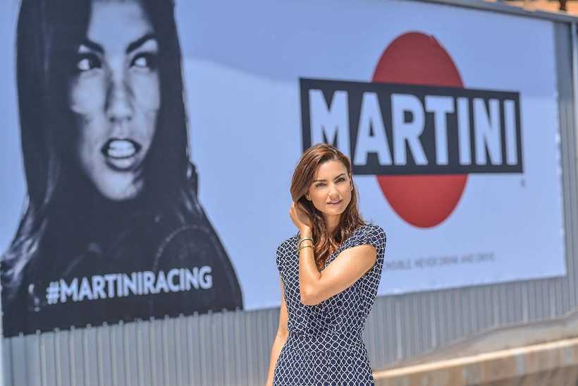 American model Jessiqa Pace stands in front of the billboard advertising Martini in 2017. Photo/Martini