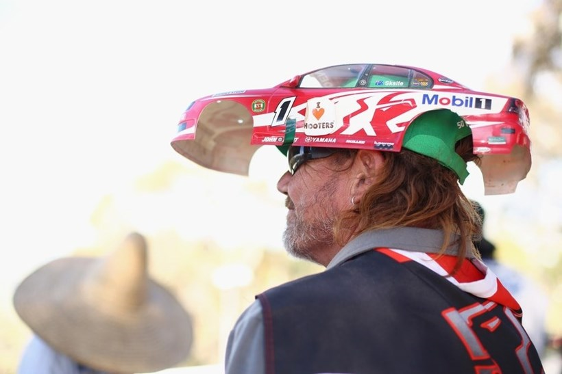 Not all fans, possibly including this man wearing a remote controlled Holden car as a hat, will be happy. Photo / Getty
