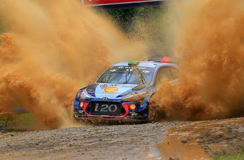 Hayden Paddon splashing his wayto third. Photos / PHOTOGRAPHY INMOTION, Greg Henderson