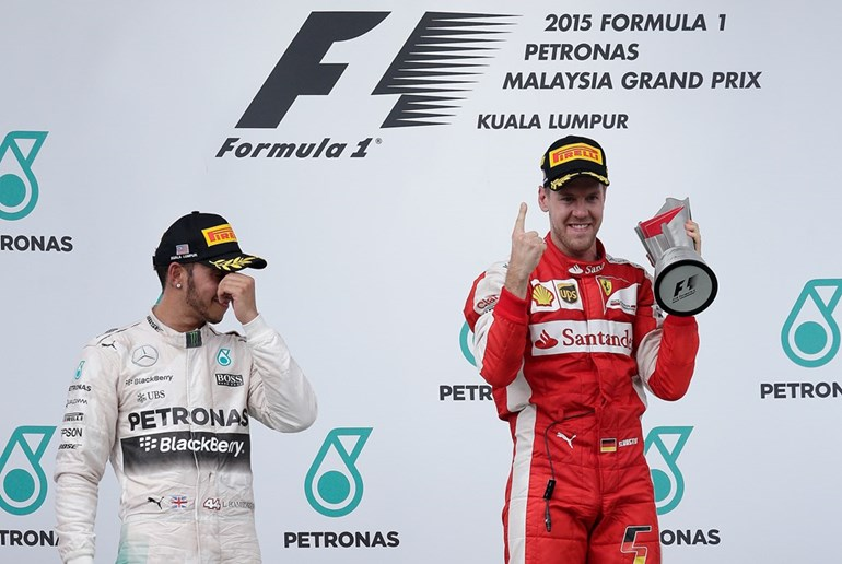 German Sebastian Vettel celebrates after beating Lewis Hamilton of Britain. Pictures / AP