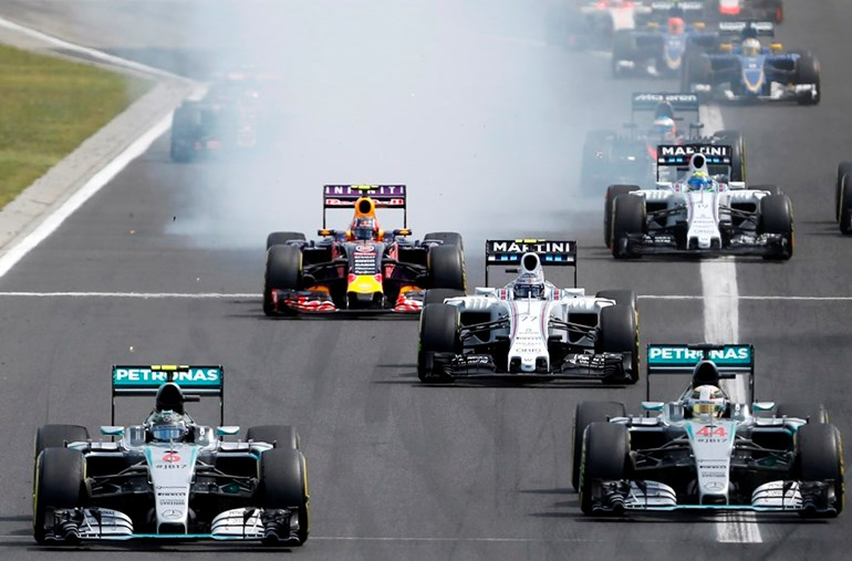 Mercedes drivers Nico Rosberg, left, Lewis Hamilton, right, lead a pack of drivers during the the Hungarian Formula One Grand Prix on Sunday, Picture/AP.