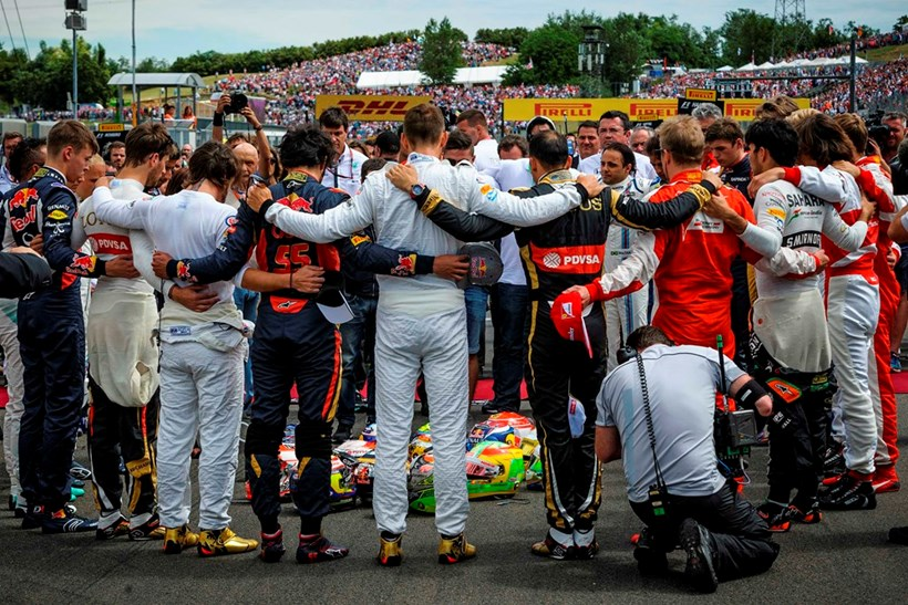 Formula One drivers embrace for a minute of silence to pay tribute to their recently deceased French colleague Jules Bianchi before the Formula One Hungarian Grand Prix.Picture/AP.