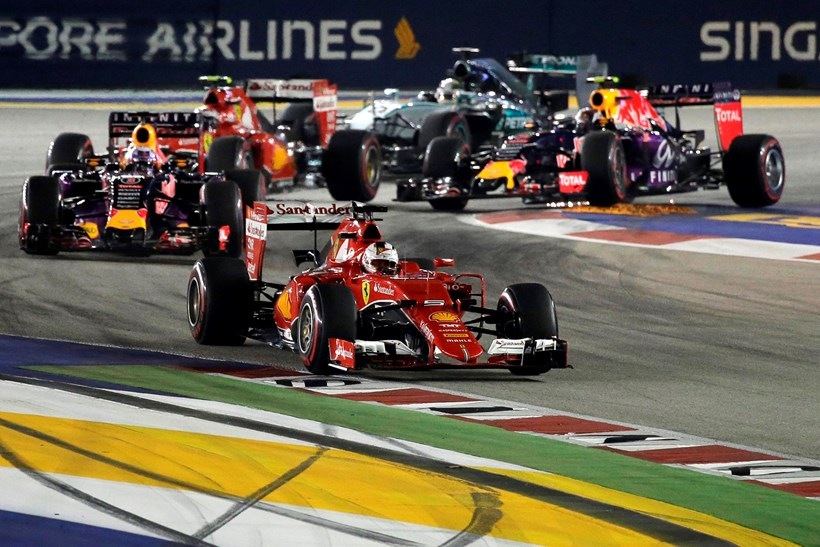 Ferrari driver Sebastian Vettel leads the field at the start of the SIngapore Grand Prix
