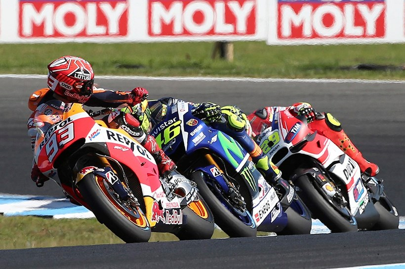 MotoGP rider Marc Marquez, left, looks back as he leads Valentino Rossi, center, and Andrea Iannone during the Australian Motorcycle Grand Prix. Photo / AP