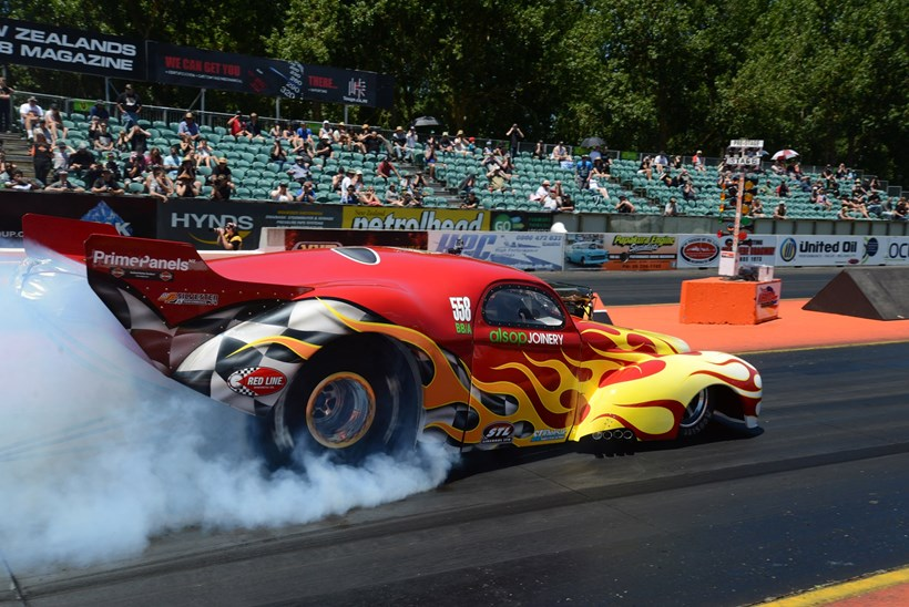 The Alsop brothers '41 Willys Coupe (above); Te Puke racer Dave Gauld wheelstands his Ford Coupe (below). Pictures / Colin Smith