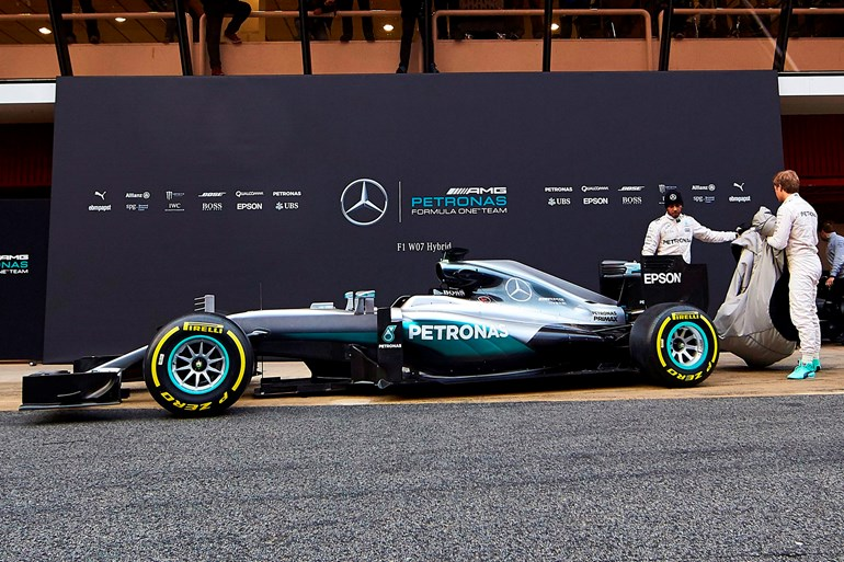 Mercedes drivers Lewis Hamilton and Nico Rosberg unveil the new F1 Mercedes W07 Hybrid car yesterday.Picture/AP