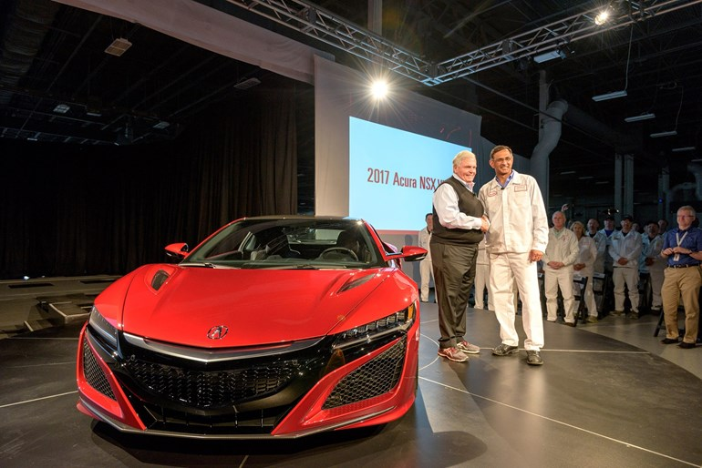 Rick Hendrick, left,  takes delivery of the first production NSX, VIN 001, from  Clement D'Souza. Picture / Supplied