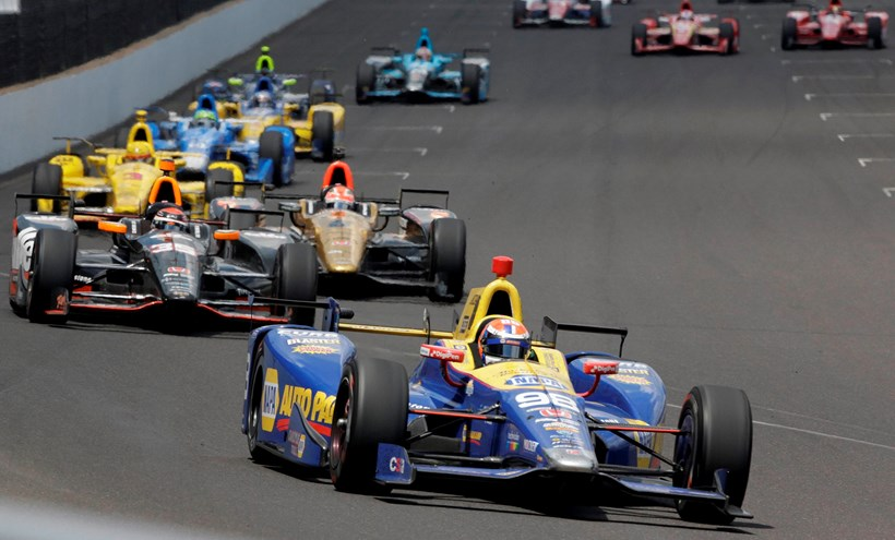 Alexander Rossi leads the field on his way to winning the 100th running of the Indianapolis 500 on Sunday. Picture/AP