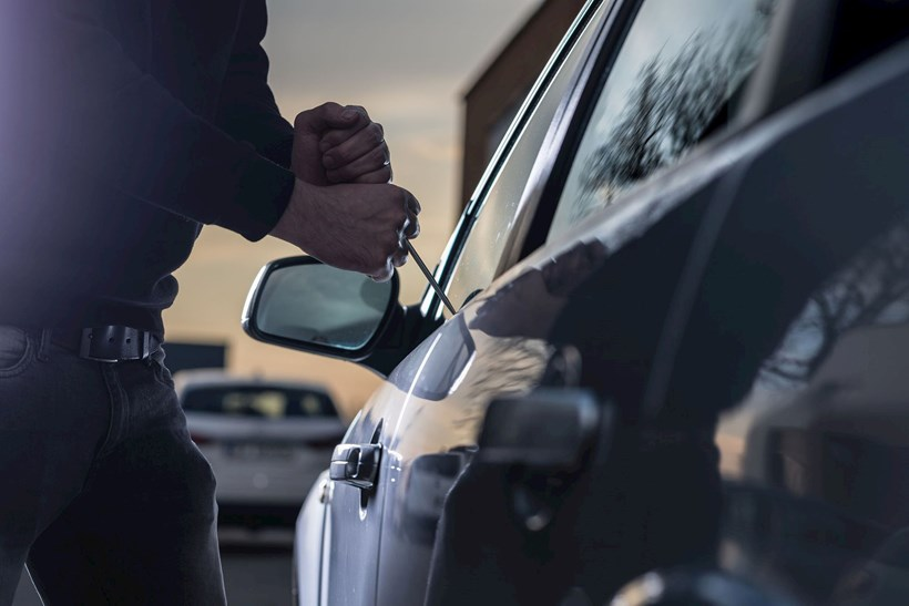 Thief trying to break into car with screwdriver. Photo / 123rf
