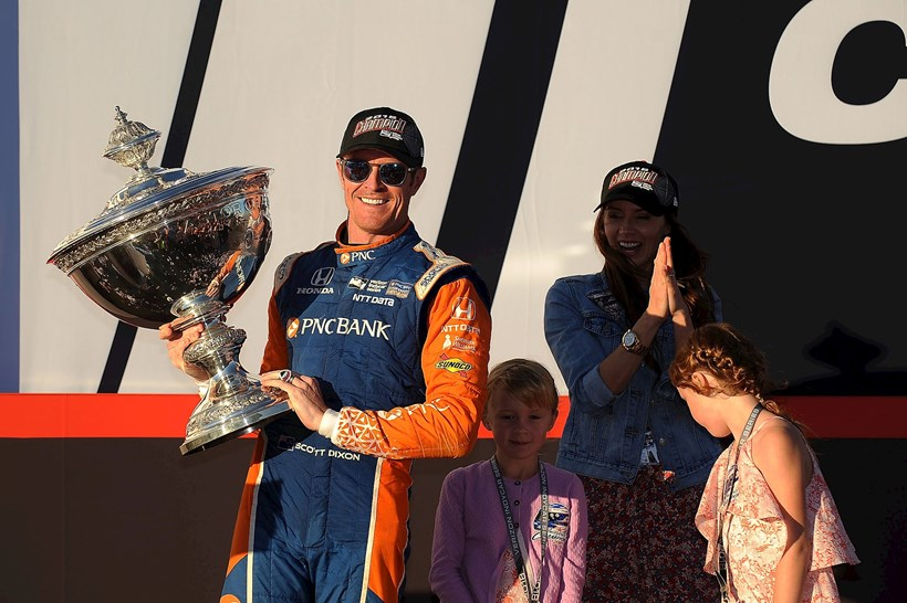 Scott Dixon celebrates title number five with his wife, Emma Davies-Dixon, and his two children, Poppy and Tilly. Photos / Getty Images