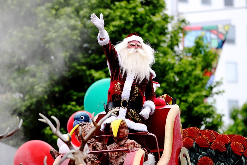 Santa waves to the crowds during the annual Farmers Santa Parade in Auckland. Photo / Getty Images